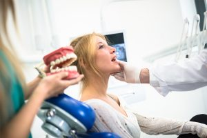 Woman having her free denture consultation